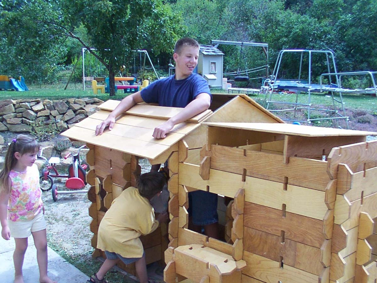 kids building a builder board playhouse
