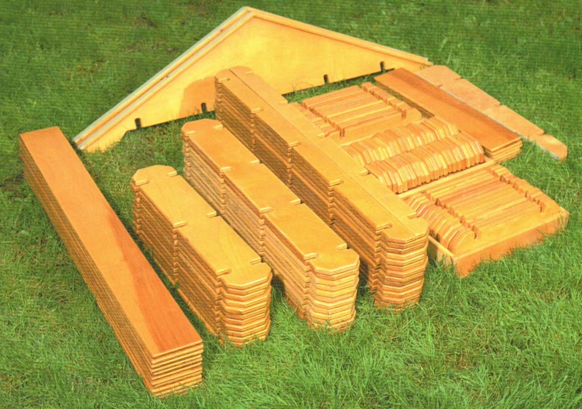 unassembled builder boards lying in the grass